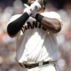 San Francisco Giants' Pablo Sandoval celebrates his solo home run against the San Diego Padres during the first inning of a baseball game in San Francisco,  Sunday, April 29, 2012.
