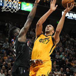 Utah Jazz center Rudy Gobert (27) shoots over the extended arms of Houston Rockets center Clint Capela (15) as the Utah Jazz host the Houston Rockets at Vivint Smart Home Arena Salt Lake on Thursday, Dec. 7, 2017.