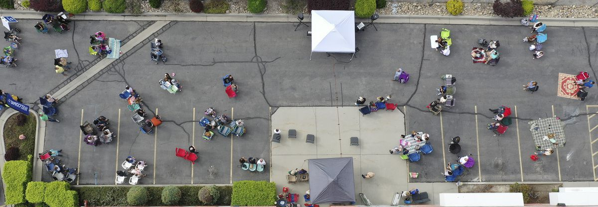 "The Mission Church members worship in a ""COVID-friendly"" service in the church parking lot in South Jordan on Sunday, May 3, 2020."