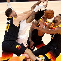 Utah Jazz forward Georges Niang (31) is called for a flagrant one foul on Memphis Grizzlies guard Ja Morant (12) as the Utah Jazz and Memphis Grizzlies play Game 2 of their NBA playoffs first round series at Vivint Arena in Salt Lake City on Wednesday, May 26, 2021. Utah won 141-129.