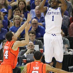 Kentucky's Darius Miller (1) shoots over Louisville's Kyle Kuric, left, and Peyton Siva (3) during the second half of an NCAA Final Four semifinal college basketball tournament game Saturday, March 31, 2012, in New Orleans.