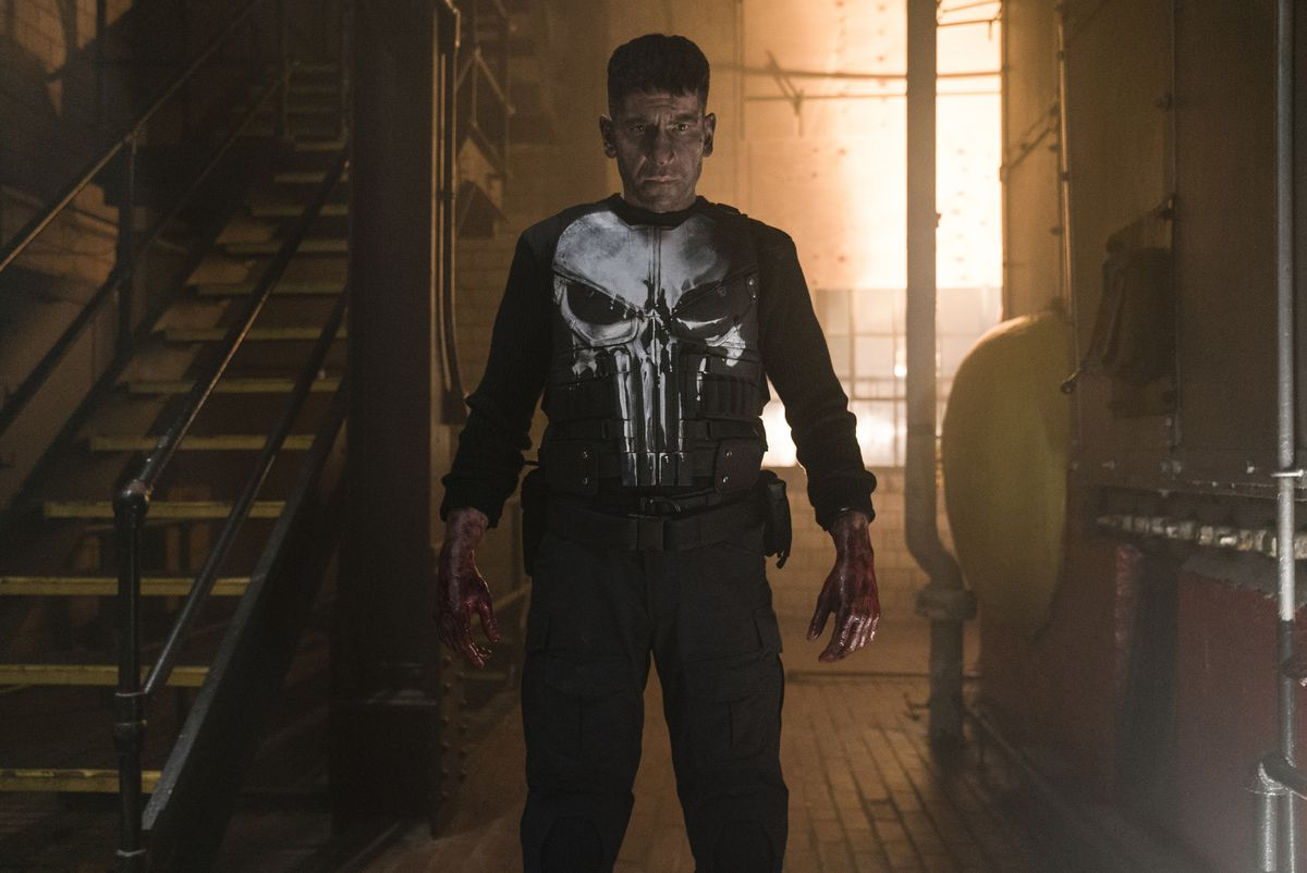 Jon Bernthal stands bloody-handed and glowering in Netflix's The Punisher.