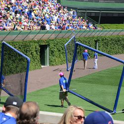 2:22 p.m. Batting practice screens being moved, using the warning track, to the outfield storage area -