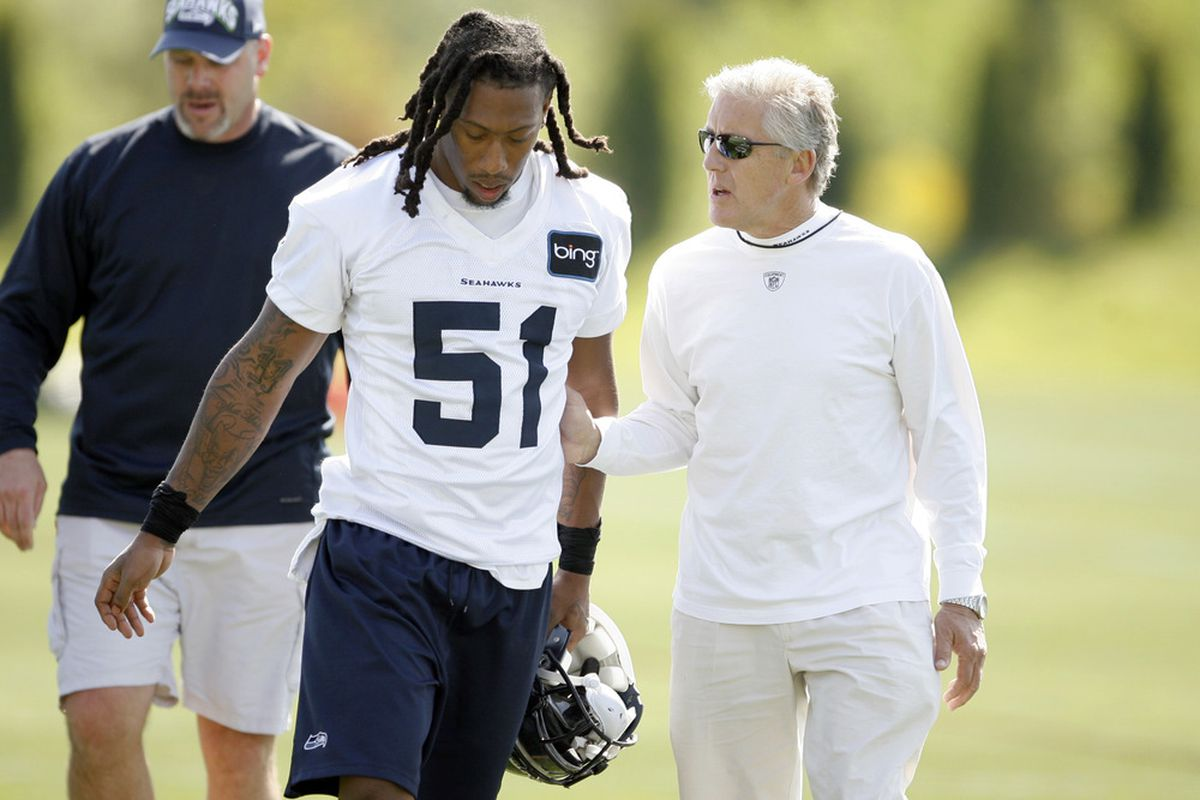 May 11, 2012; Renton, WA, USA; Seattle Seahawks head coach Pete Carroll speaks with defensive end Bruce Irvin (51) following a minicamp practice at the Virginia Mason Athletic Center. Mandatory Credit: Joe Nicholson-US PRESSWIRE