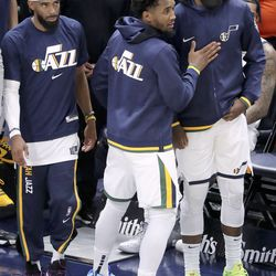Utah Jazz guards Mike Conley (11) and Donovan Mitchell (45) and forward Royce O'Neale (23) walk out onto the court after an NBA preseason game at Vivint Arena in Salt Lake City on Monday, Oct. 11, 2021. The Jazz won 127-96.