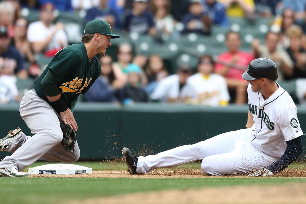 SEATTLE, WA - SEPTEMBER 09:  Michael Saunders #55 of the Seattle Mariners triples against Josh Donaldson #20 of the Oakland Athletics at Safeco Field on September 9, 2012 in Seattle, Washington.  (Photo by Otto Greule Jr/Getty Images)