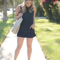 """Emily of <a href=""""http://cupcakesandcashmere.com""""target=""""_blank"""">  Cupcakes and Cashmere</a> is wearing a Club Monaco romper, a vintage scarf and a Joie bag."""