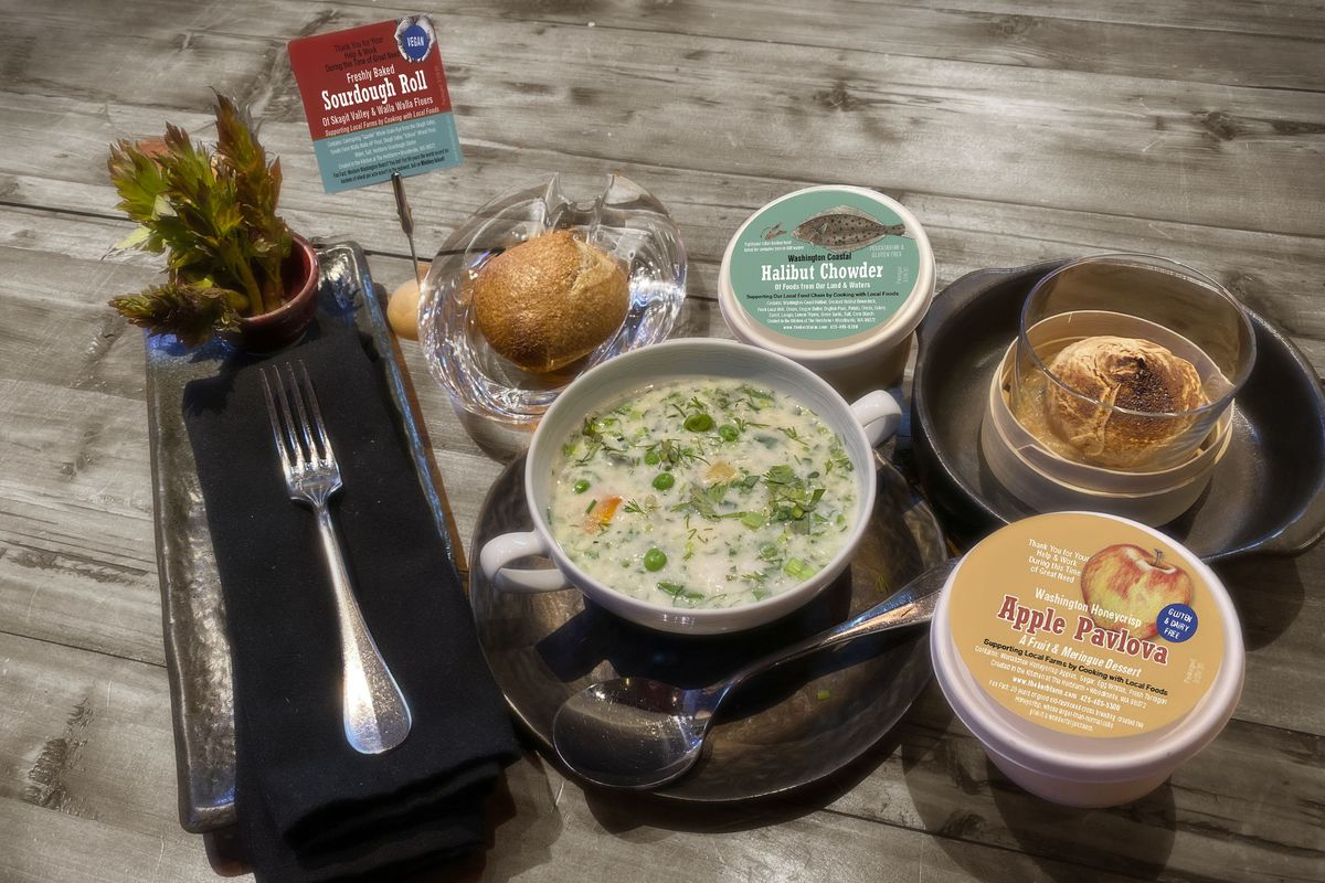 A to-go meal package from The Herbfarm with soup, bread, and sides