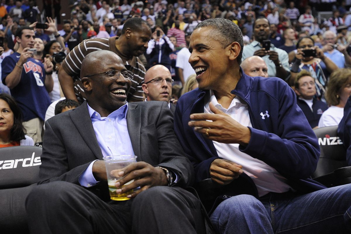 WASHINGTON, DC - JULY 16: U.S. President Barack Obama shares a laugh with former White House aide Reggie Love as they watch the US Senior Men's National Team and Brazil play during a pre-Olympic exhibition basketball game at the Verizon Center on Jul