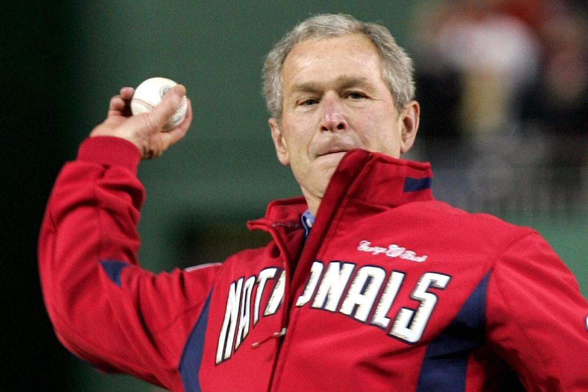 US President George W. Bush throws out t