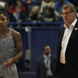 UConn's Crystal Dangerfield (5) and head coach Geno Auriemma look on during the Notre Dame Fighting Irish vs UConn Huskies women's college basketball game in the Women's Jimmy V Classic at the XL Center in Hartford, CT on December 3, 2017.