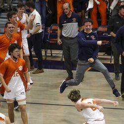 The Brighton coaches and players leap from the bench as they defeat Orem in overtime in a second round boys 5A state basketball tournament game at Brighton High School in Cottonwood Heights on Friday, Feb. 26, 2021.