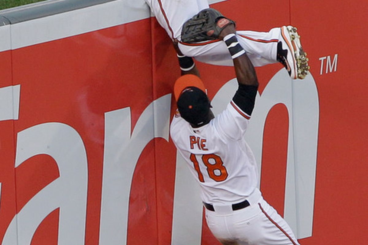 In Felix Pie's most productive move as an Oriole yet, he helps Adam Jones back over the fence.