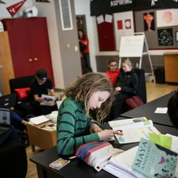Isaac Rogers, 13, and other students study and hang out in the Our CASA space at West High School in Salt Lake City on Friday, Feb. 24, 2017. Our CASA spaces are part of an initiative to increase access to higher education for first-generation students and their families on Salt Lake City's west side. Isaac is part of the Extended Learning Program that allows middle schoolers to take high school courses.