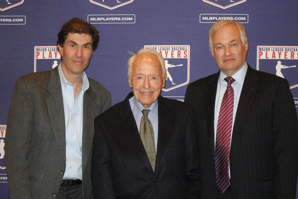 In a photo provided by the Major League Baseball Players Association, Michael Weiner, left, MLBPA executive director; Marvin Miller, center, former head of the association; and Donald Fehr, former MLBPA executive director and currently the executive direc