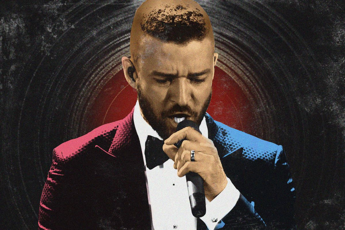 Justin Timberlake wearing a tux and holding a microphone