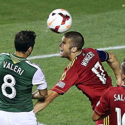 """Real's Chris Wingert heads the ball away from Diego Valeri as Real Salt Lake and Portland Timbers play Wednesday, Aug. 7, 2013 at Rio Tinto Stadium. Real won 2-1.  <img src=""""http://beacon.deseretconnect.com/beacon.gif?cid=234840&pid=83"""" />"""