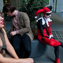 Attendees sit outside a hotel at Dragon Con in Atlanta, on Friday, Aug. 31, 2012. The annual science fiction and fantasy convention drew big crowds and had more than 30,000 pre-registered attendees.