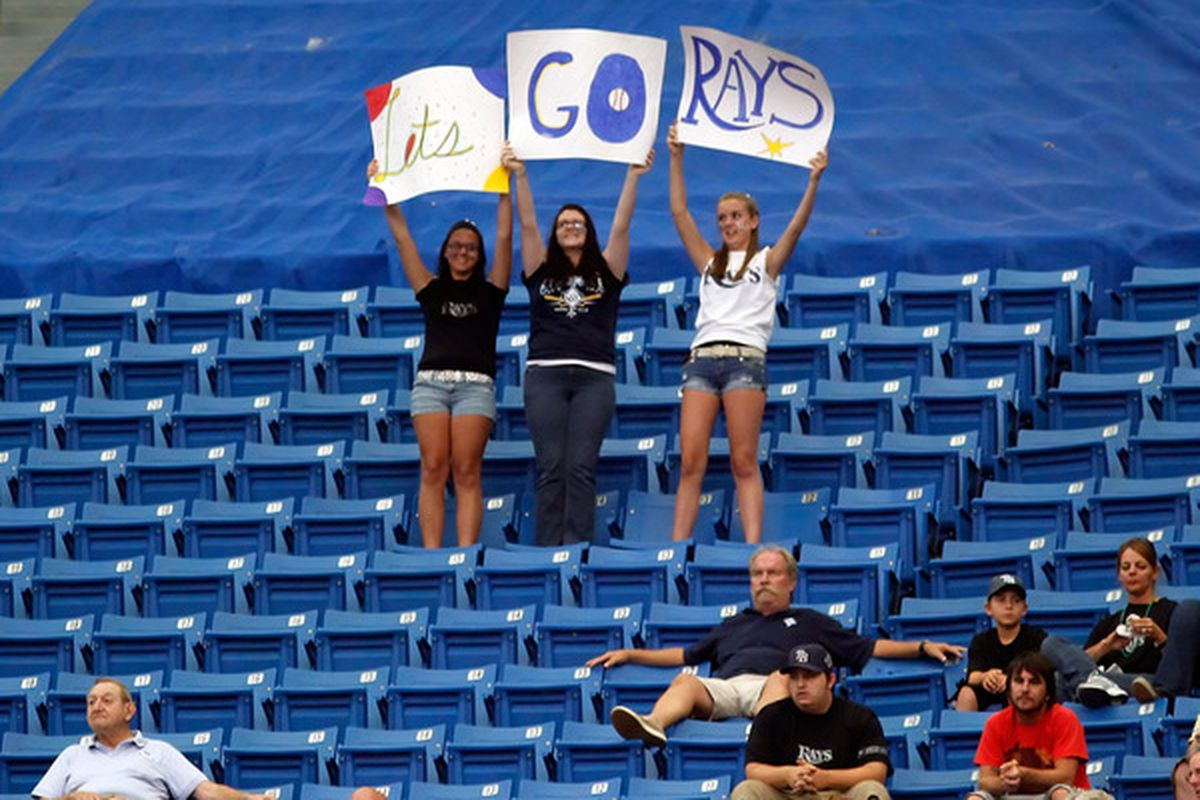 ST. PETERSBURG - JUNE 13:  Fans of the Tampa Bay Rays cheer on their team against the Florida Marlins during the game at Tropicana Field on June 13, 2010 in St. Petersburg, Florida.  (Photo by J. Meric/Getty Images)