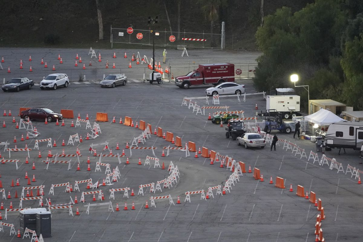 Drivers with a vaccine appointment enter a mega COVID-19 vaccination site set up in the parking lot of Dodger Stadium in Los Angeles on Saturday.