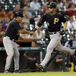 Pittsburgh Pirates' Garrett Jones, right, is congratulated by third base coach Nick Leyva, left, after hitting a home run during the eighth inning of a baseball game against the Houston Astros, Friday, Sept. 21, 2012, in Houston.