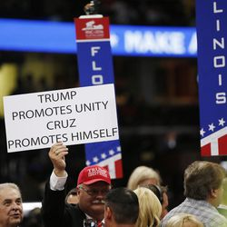 Signs are held during the final night of the National Republican Convention in Cleveland on Thursday, July 21, 2016.