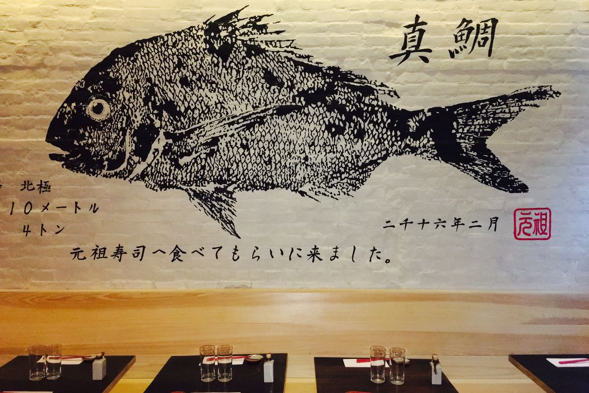 """The dining room at Sushi Ganso, where a print by artist Momoyo Torimitsu says """"I am here to be eaten"""" in Japanese"""