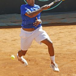 French tennis player Jo-Wilfried Tsonga returns the ball to U.S. player John Isner, during their match, in the quarterfinal of the Davis Cup between France and U.S. in Monaco Sunday April 8, 2012. (AP Photo/Remy de la Mauviniere)