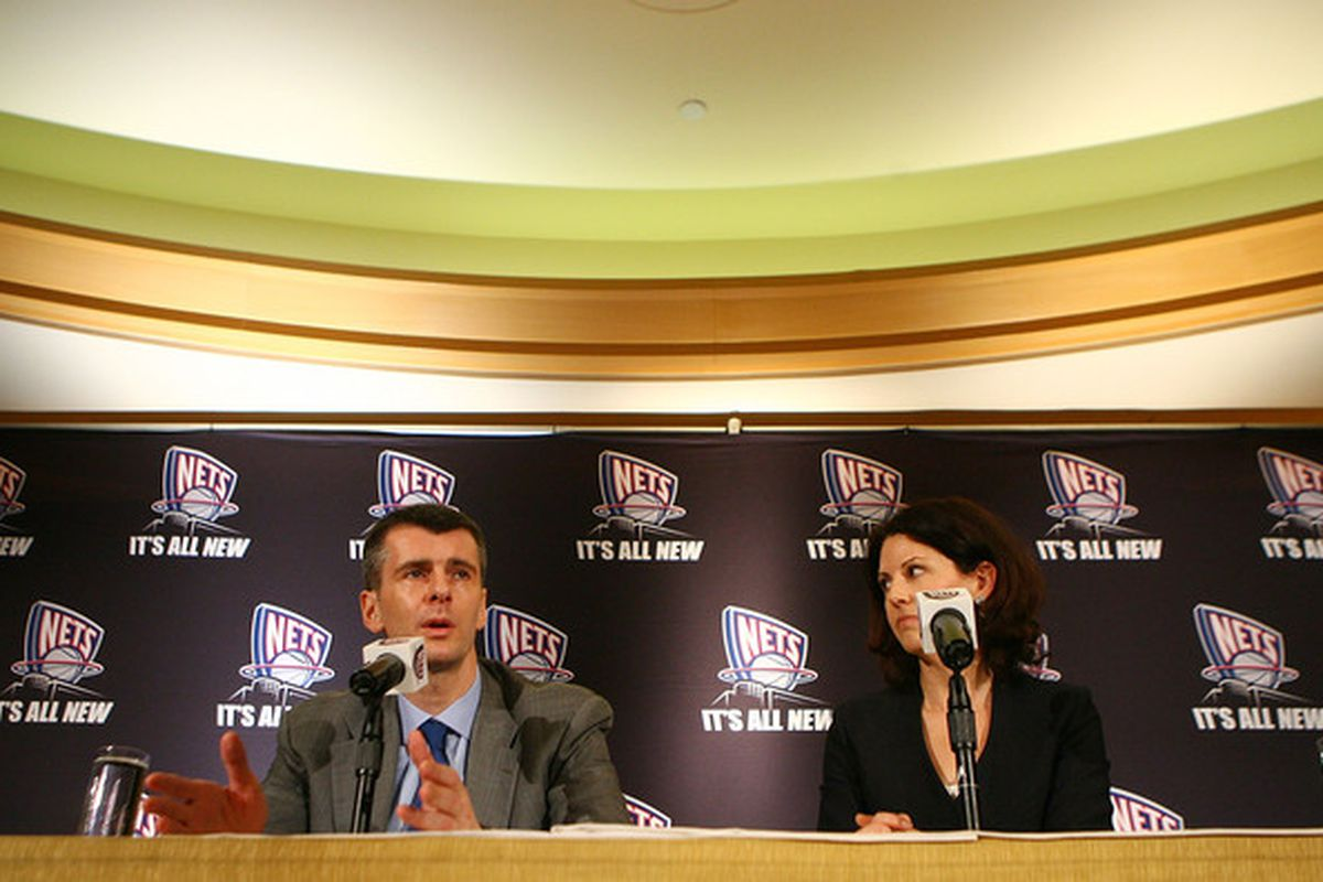 NEW YORK - MAY 19:  New Jersey Nets Owner Mikhail Prokhorov and Communication Director Ellen Pinchuk addess the media during a press conference at the Four Seasons Hotel on May 19, 2010 in New York City.  (Photo by Mike Stobe/Getty Images)