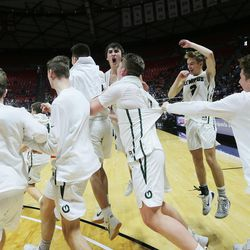 Olympus celebrates their win over Corner Canyon the 5A basketball championship in the Jon M. Huntsman Center at the University of Utah on Saturday, March 3, 2018.