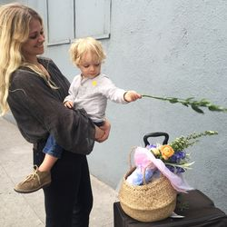 Katherine Kleveland (with son Shep) wore a breezy blouse by her owb label, Doen, and a Birkin-esque basket.