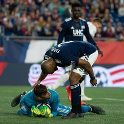 FOXBOROUGH, MA - MAY 25: New England Revolution defender Andrew Farrell #2 pats goalkeeper Matt Turner #30 on his head after Turner made an outstanding save in the first half at Gillette Stadium on May 25, 2019 in Foxborough, Massachusetts. (Photo by J. Alexander Dolan - The Bent Musket)