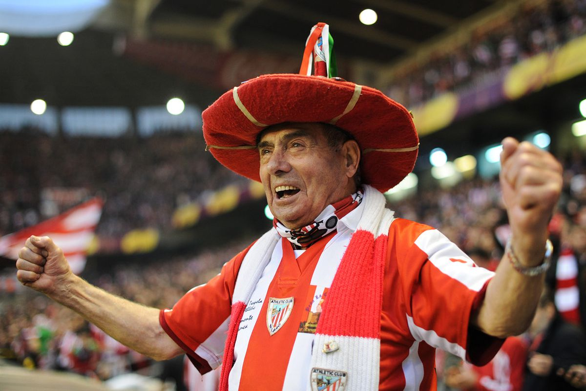 An Athletic Bilbao fan cheers on his team.