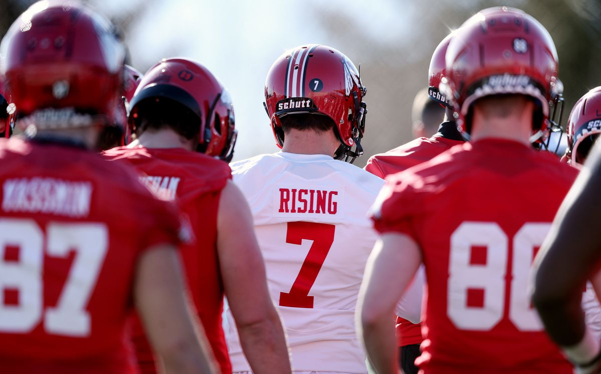Quarterback Cameron Rising and other players circle up as head coach Kyle Whittingham calls the team together as the University of Utah football team opens spring camp in Salt Lake City on Monday, March 2, 2020.