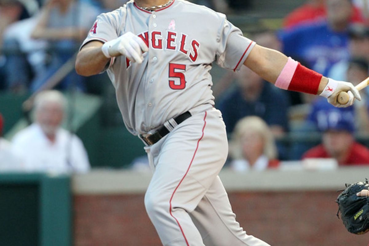 ARLINGTON, TX - MAY 13: Albert Pujols #5 of the Los Angeles Angels of Anaheim watches his fly ball to left field against the Texas Rangers on May 13, 2012 in Arlington, Texas. (Photo by Layne Murdoch/Getty Images)