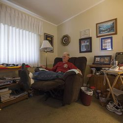 Eighty-seven-year-old retired Marine John Cole, who served and was wounded in North Korea, sits in his home in Roy Wednesday, Feb. 18, 2015.