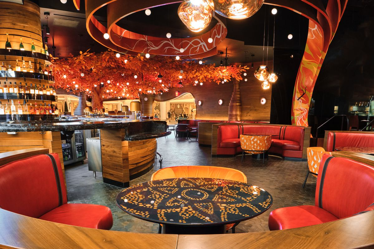 The lounge with leather seats that look out on the new orange leaf tree.