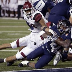 Utah State running back LaJuan Hunt (21) scores a touchdown in the second half during the Arizona Bowl NCAA college football game against New Mexico State, Friday, Dec. 29, 2017, in Tucson, Ariz. (AP Photo/Rick Scuteri)