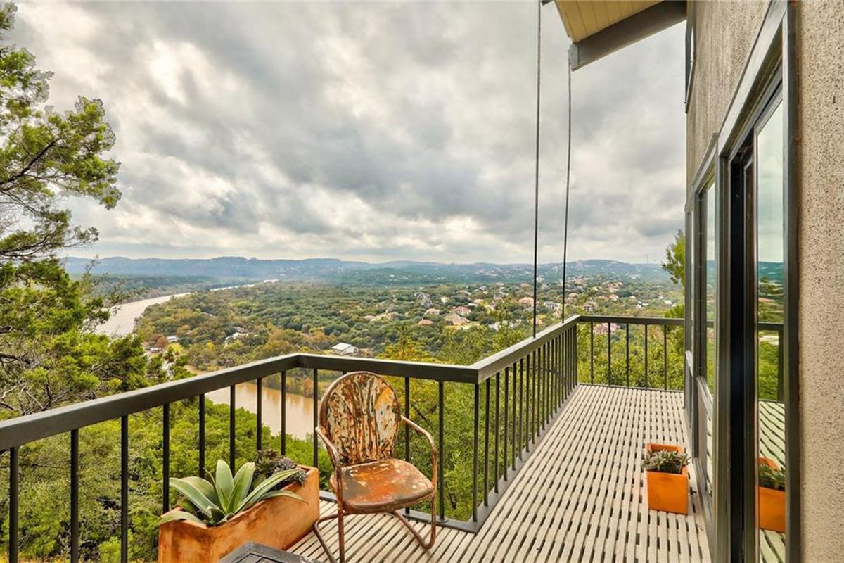 Balcony of home overlooking river and Hill Country
