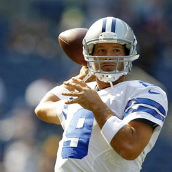 Dallas Cowboys quarterback Tony Romo throws in warm ups before an NFL football game against the Seattle Seahawks, Sunday, Sept. 16, 2012, in Seattle.