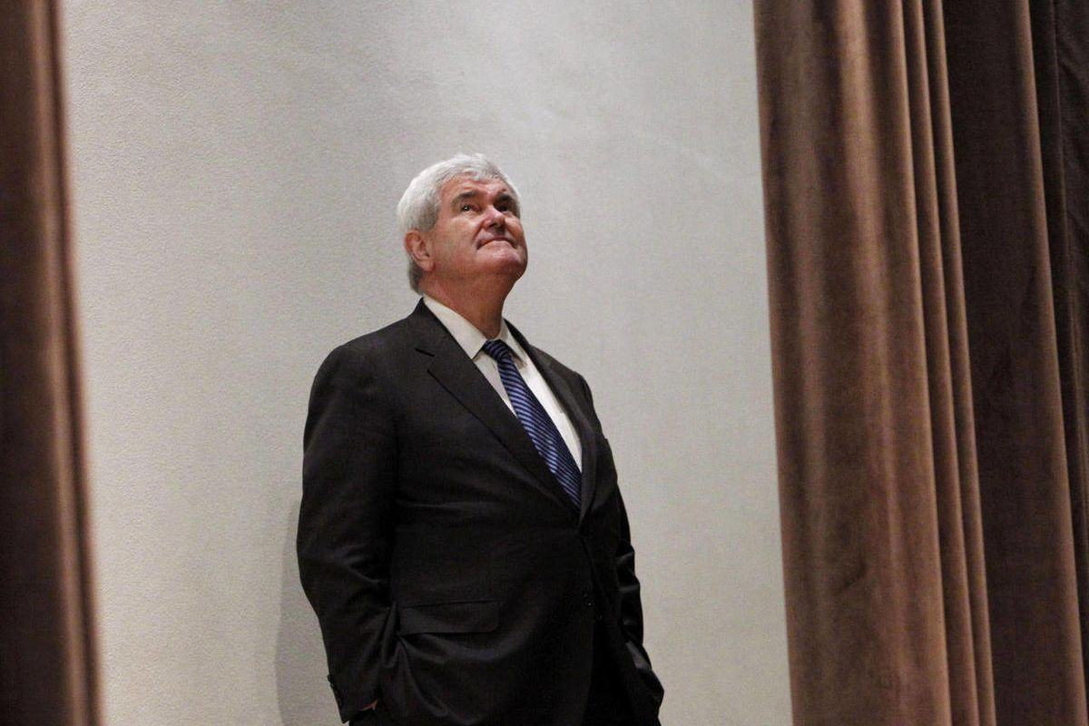FILE - In this April 2, 2012, file photo Republican presidential candidate, former House Speaker Newt Gingrich, waits to speak at a campaign stop in Frederick, Md.. Gingrich, who once led his rivals for the nomination in polls, is today millions in debt a