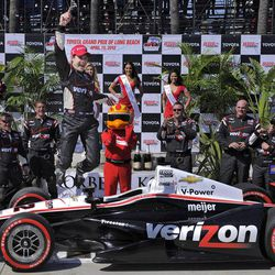 Will Power, of Australia, jumps off of his car after winning the IndyCar Series' Toyota Grand Prix of Long Beach auto race, Sunday, April 15, 2012, in Long Beach, Calif.