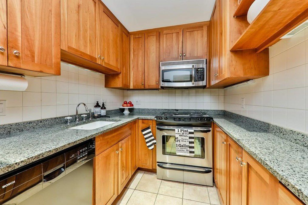 A kitchen with a U-shaped counter.