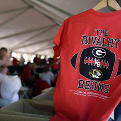 Shirts hang up for sale at a University of Georgia Alumni Association tailgate before the start of an NCAA college football game between Georgia and Missouri Saturday, Sept. 8, 2012, in Columbia, Mo. The football game will be the first for Missouri against a Southeastern Conference opponent since joining the conference.