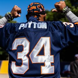 One fan points affectionately to the name Payton on the back of his jersey.