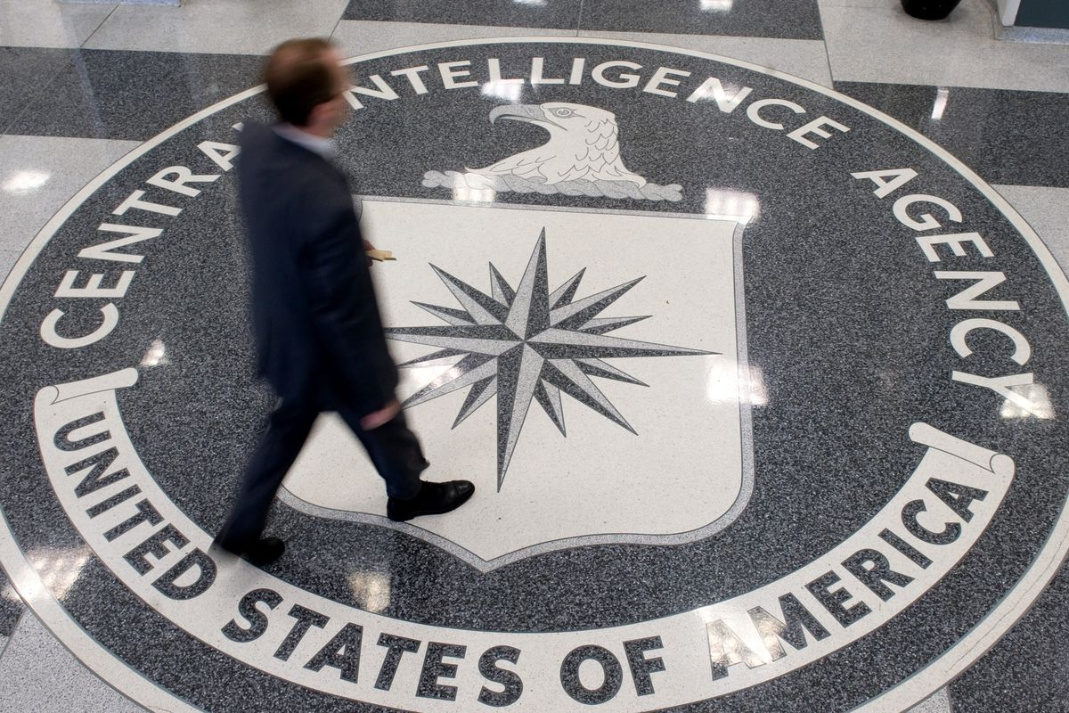 A man crosses the Central Intelligence Agency seal in the lobby of CIA Headquarters in Langley, Virginia, on August 14, 2008.