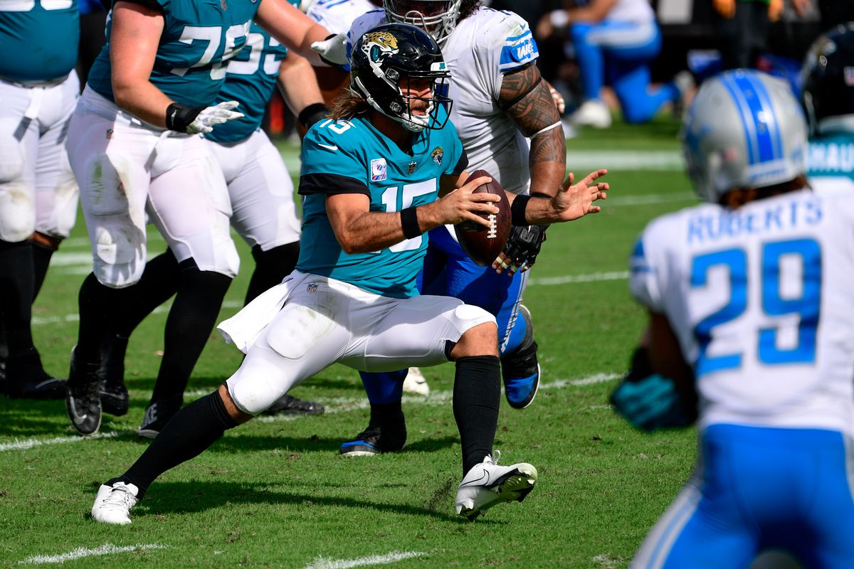 Jacksonville Jaguars quarterback Gardner Minshew II (15) runs the ball in for a touchdown against the Detroit Lions during the second half at TIAA Bank Field.