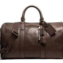 """<a href=""""http://f.curbed.cc/f/Coach_SP_121113_duffle"""">Bleecker duffle in brass/mahogany leather</a>,  $698"""