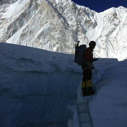 Dave Roskelley pauses for a photo after climbing the ladder. The ascent of Mount Everest required the use of many ladders.