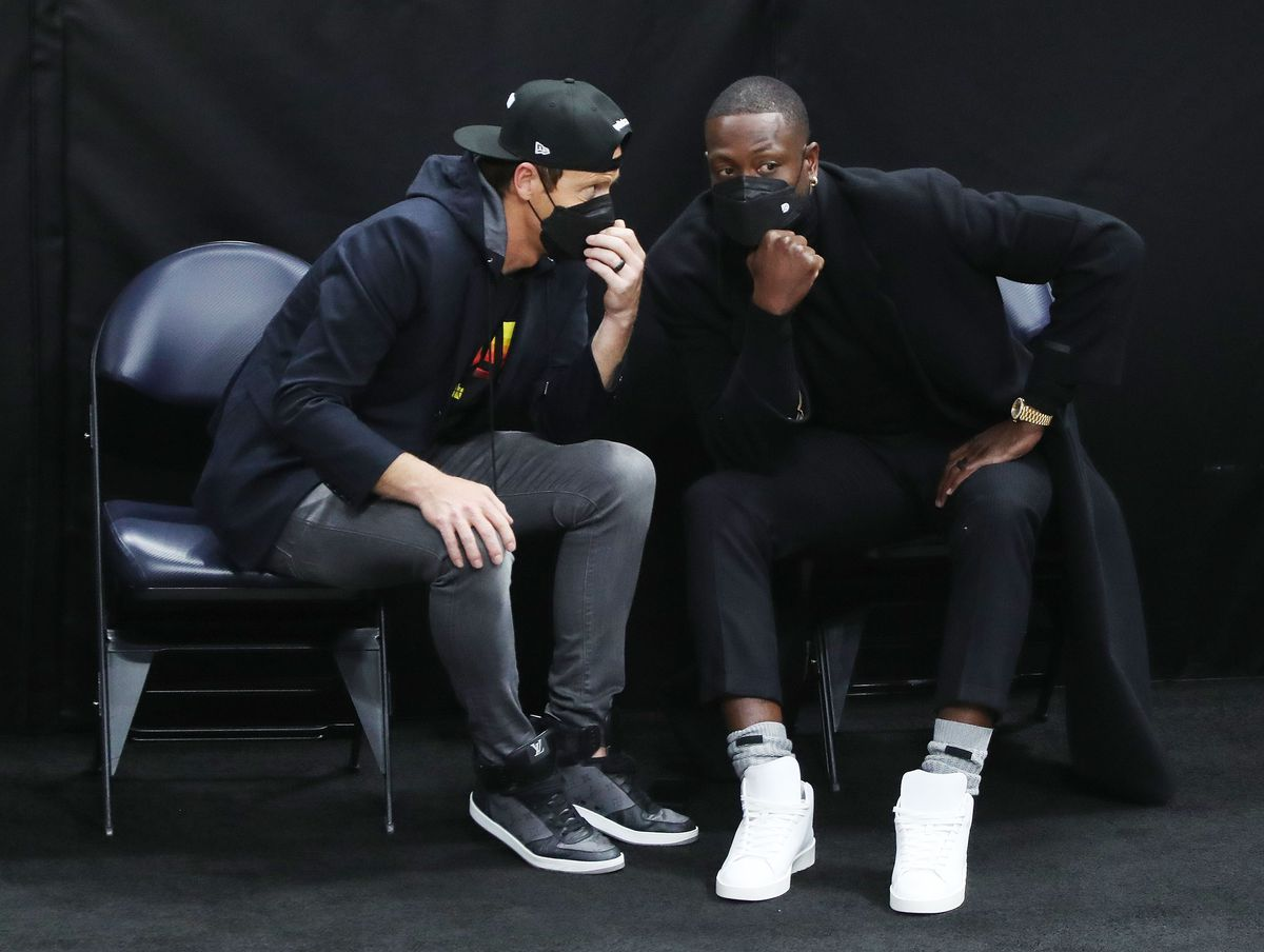 Utah Jazz owner Ryan Smith, left, and Dwayne Wade, who bought a share of the team, talk during a game at the Vivint Arena in Salt Lake City on Friday, April 16, 2021.